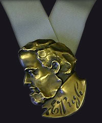 The Evan Pugh Medal, a bronze sculpted award on a ribbon.