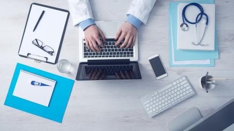 Picture of doctor with computer
