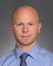 A staff photo of John Radan.
