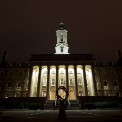 This is a picture of Old Main at night.